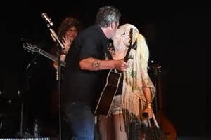 Gwen Stefani looks very much in love with beau Blake Shelton as they kiss onstage at the California Mid-state Fair