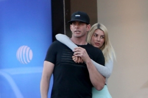 Tarek El Moussa's girlfriend Heather Rae Young puts her arms around him as they step out for a date in Beverly Hills