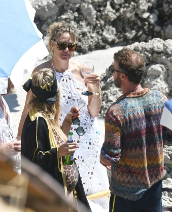 Heidi Klum Kisses Husband Tom Kaulitz as She Celebrates Post-Wedding Festivities in All-White