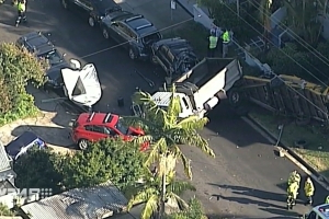 Sydney street becomes wrecking yard as truck takes out cars