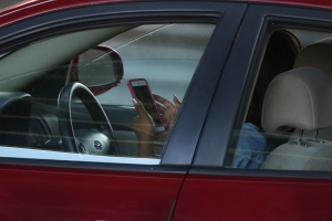 Using hands-free mobile phones while driving could be banned under MPs plans