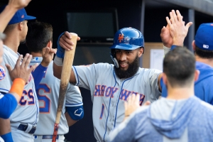 Alonso, Rosario give Mets enough of a cushion to beat Braves