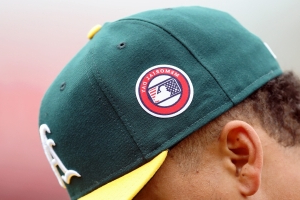 Speed pitch signee fans all 3 in A's minor league debut