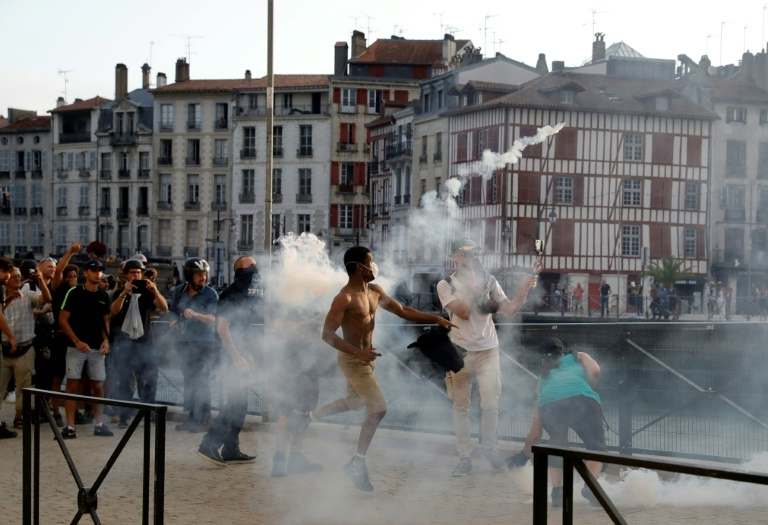 French police fire tear gas at anti-G7 protesters near summit