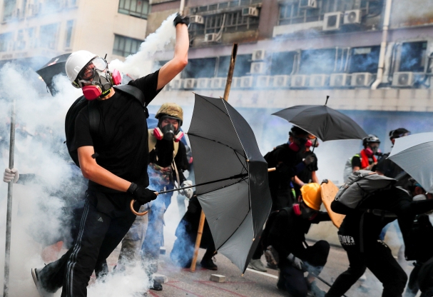 Hong Kong police arrest 29 as city returns to violence, further protests planned