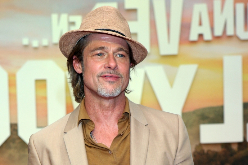 Brad Pitt Debuts New Mysterious Bicep Tattoo at the Venice Film Festival
