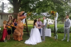A woman showed up to her sister's wedding in a dinosaur suit after she was told she could wear 'anything'
