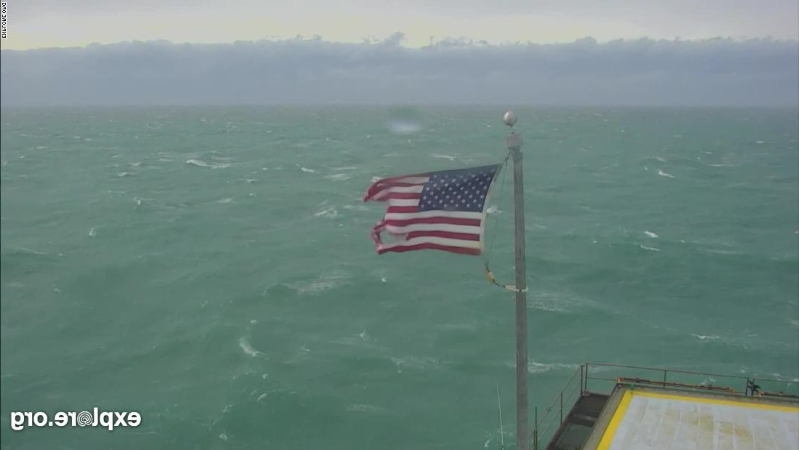 American flag torn but still flying at former Coast Guard station after Hurricane Dorian
