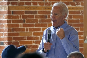 In intimate moment, Biden vows to 'end fossil fuel'