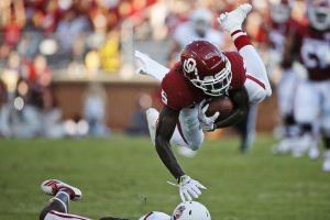 Hurts throws 3 TD passes, No. 4 Oklahoma routs South Dakota