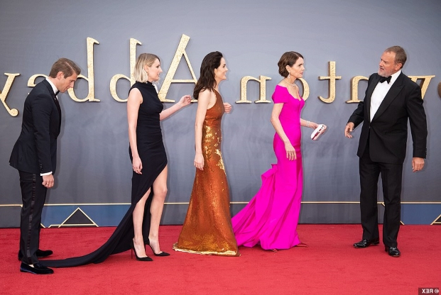 Downton Abbey Movie: Michelle Dockery dazzles in a sequined gold gown as she joins glamorous co-stars Elizabeth McGovern and Laura Carmichael on the red carpet at the world premiere