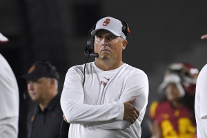 USC coach Clay Helton was in the dark about the fate of Lynn Swann