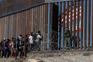 Is Trump following through on the wall, slowing illegal immigration?