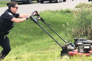 Officers step in to help exhausted mom – by mowing her lawn
