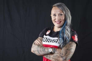 Olympic bob champ Kaillie Humphries says she's forced to slide for U.S.
