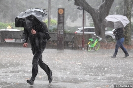 Four seasons in one day: Big wet smashes the east coast with the heaviest rain in months - as bushfire danger remains while SNOW falls in other parts