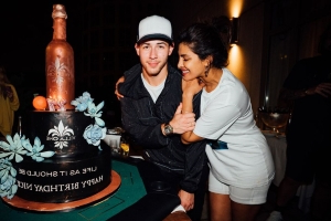 Nick Jonas's 27th Birthday Party Included Pizza, Tequila, And A Massive Cake With A Villa One Bottle On Top