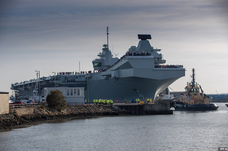 a large ship in a body of water: The sister ship of HMS Queen Elizabeth will now begin nine weeks of sea trials before heading into Portsmouth Naval base