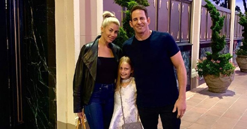 a man and a woman standing in front of a building: Tarek El Moussa Says His Daughter Asked If His New Girlfriend Could Join Them on Their Date Night