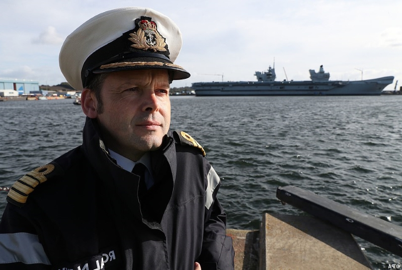a man wearing a hat and a boat in the water: Captain Darren Houston, the commanding officer of HMS Prince of Wales, said ahead of the departure that he was not worried (pictured: September 13)