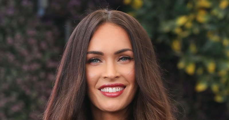 Megan Fox smiling for the camera: Megan Fox Opens Up About Son Noah's Decision to Wear Dresses: 'Be Confident No Matter What'