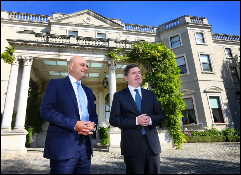 Paschal Donohoe, Sajid Javid are posing for a picture: Talks: Finance Minister Paschal Donohoe greets UK Chancellor Sajid Javid on his arrival at Farmleigh. Photo: Steve Humphreys