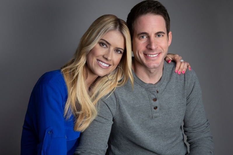 Tarek Moussa posing for the camera: Tarek El Moussa and Christina Anstead | Aaron Rapoport/Getty Images
