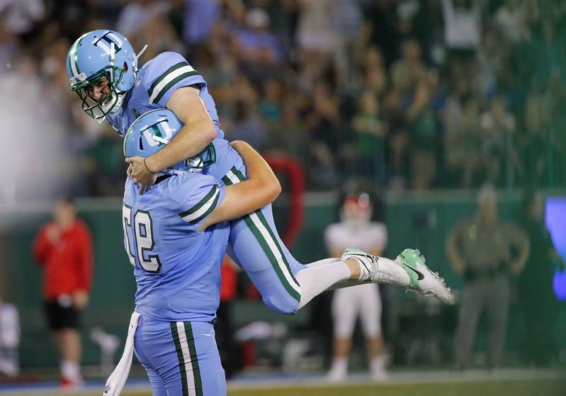 Tulane Green Wave place kicker Graham Dable (67) celebrates with Tulane Green Wave holder Ryan Wright (97) after a field goal against the Houston Cougars during the fourth quarter at Yulman Stadium on September 19, 2019.