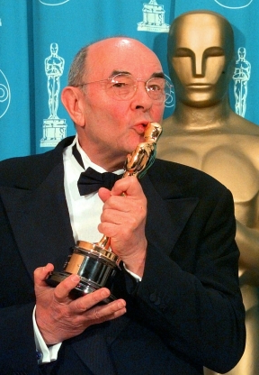 Slide 128 of 163: FILE - In this March 23, 1998 file photo, director Stanley Donen kisses the Oscar he received for Lifetime Achievement backstage at the 70th Academy Awards at the Shrine Auditorium in Los Angeles. Donen, whose