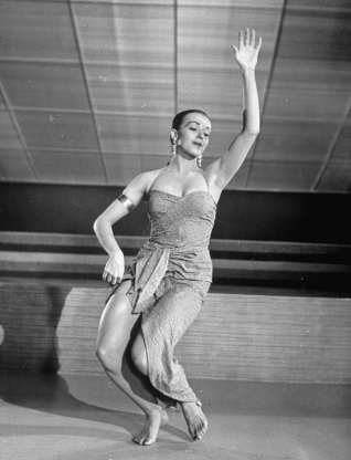 Slide 134 of 163: Dancer Nita Bieber, 23, performing an energetic native voodoo number on dance floor of Rio nightclub in the movie Nance Goes to Rio on set at M-G-M Studios.  (Photo by Alfred Eisenstaedt/The LIFE Picture Collection/Getty Images)