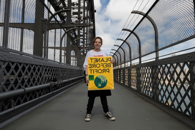 Slide 34 of 115: SYDNEY, AUSTRALIA - SEPTEMBER 20: A young climate protestor on Sydney Harbour Bridge on September 20, 2019 in Sydney, Australia. Rallies held across Australia are part of a global mass day of action demanding action on the climate crisis.  (Photo by Brook Mitchell/Getty Images)