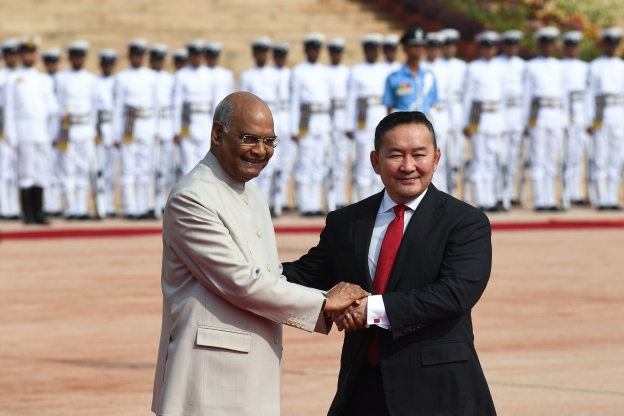 Slide 35 of 115: India President Ram Nath Kovind (R) shakes hands with Mongolia's President Khaltmaagiin Battulga during a ceremonial reception at the President House in New Delhi on September 20, 2019. (Photo by Prakash SINGH / AFP)        (Photo credit should read PRAKASH SINGH/AFP/Getty Images)