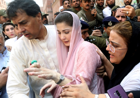 Slide 36 of 115: Muhammad Safdar, right, escorts his wife Maryam Nawaz, daughter of arrested former Prime Minister Nawaz Sharif, to an accountability court in Lahore, Pakistan, Wednesday, Sept.18, 2019. The court summoned her for using a bogus trust deed in the Avenfield properties case. (AP Photo/K.M. Chaudhry)