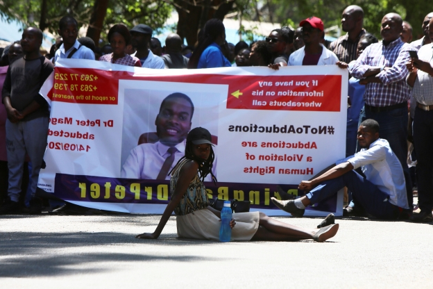 Slide 38 of 115: Zimbabwean doctors protest in Harare, Wednesday, Sept, 18, 2019. Zimbabwean doctors protesting the alleged abduction of a union leader were met by a line of baton- wielding police in the capital as fears grow about government repression. (AP Photo/Tsvangirayi Mukwazhi)