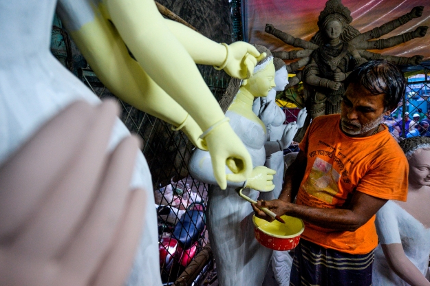 Slide 42 of 115: An artist works on a clay idol of the Hindu goddess Durga in preparation for the upcoming Hindu festival 'Durga Puja' in Old Dhaka on September 18, 2019. (Photo by MUNIR UZ ZAMAN / AFP)        (Photo credit should read MUNIR UZ ZAMAN/AFP/Getty Images)