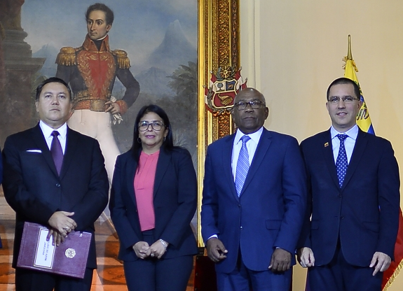 Slide 45 of 115: (L to R) Venezuelan Foreign Minister Jorge Arreaza, Education Minister Aristobulo Isturiz, Vice President Delcy Rodriguez and opposition member Javier Bertucci pose after signing a dialogue agreement between the government and the opposition in Caracas on Spetember 18, 2019. (Photo by Matias Delacroix / AFP)        (Photo credit should read MATIAS DELACROIX/AFP/Getty Images)