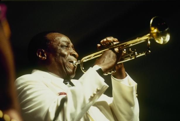 Slide 48 of 163: NEW ORLEANS - MAY 01 : Dave Bartholomew performs on stage at the New Orleans Jazz and Heritage Festival in New Orleans, Louisiana on May 01, 1994. (Photo by David Redfern/Redferns)