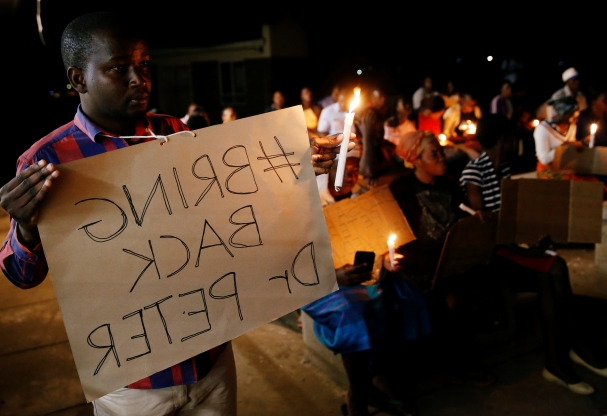 Slide 52 of 115: Zimbabwean healthcare workers hold a candlelight vigil to protest over the disappearance of Peter Magombeyi, the leader of their union in Harare, Zimbabwe September 17, 2019. REUTERS/Philimon Bulawayo