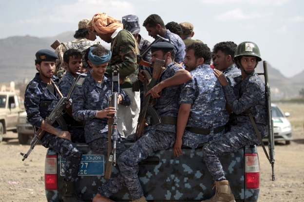 Slide 64 of 115: Yemeni Shiite Huthi police forces sit in the back of a military vehicle in the capital Sanaa during a protest against the Saudi intervention in their country on September 17, 2019. - The Huthis, who captured the Yemeni capital Sanaa in 2014, have been fighting against a Saudi-led coalition that intervened the following year in support of the internationally recognised government. (Photo by MOHAMMED HUWAIS / AFP) (Photo credit should read MOHAMMED HUWAIS/AFP/Getty Images)