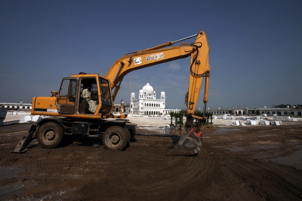 Slide 72 of 115: A machinery operates to level the site at the Gurdwara Darbar Sahib, which will be open this year for Indian Sikh pilgrims, in Kartarpur, Pakistan September 16, 2019. REUTERS/Mohsin Raza