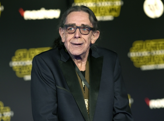 Slide 77 of 163: RETRANSMISSION TO CORRECT DAY AND DATE OF DEATH - FILE - In this Dec. 14, 2015, file photo, Peter Mayhew arrives at the world premiere of