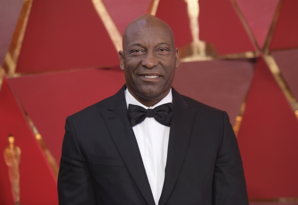 Slide 78 of 163: FILE - This March 4, 2018 file photo shows John Singleton at the Oscars in Los Angeles. Oscar-nominated filmmaker John Singleton has died at 51, according to statement from his family, Monday, April 29, 2019. He died Monday after suffering a stroke almost two weeks ago. (Photo by Richard Shotwell/Invision/AP, File)