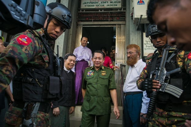 Slide 81 of 115: Myanmar's commander-in-chief, Senior General Min Aung Hlaing (C) leaves after visiting a Muslim Free Hospital and Medical Relief Society in Yangon on September 17, 2019. (Photo by Sai Aung MAIN / AFP) (Photo credit should read SAI AUNG MAIN/AFP/Getty Images)
