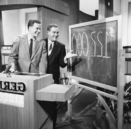 Slide 91 of 163: Pictured: (l-r) Host Jack Barry, Contestant Charles Van Doren  (Photo by NBC/NBCU Photo Bank via Getty Images)