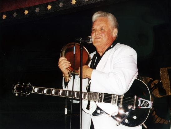 "Slide 95 of 163: This 2002 photo released by Redbush Classics Records shows rockabilly Hall of Famer Billy Adams performing in Hemsby, England. Adams, who wrote and recorded a rockabilly staple ""Rock, Pretty Mama,"" died Saturday, March 30, 2019, in Westmoreland, Tenn. He was 79. (Redbush Classics Records via AP)"