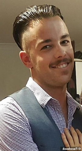 a person wearing a suit and tie: Matthew Hills (pictured), from the Gold Coast, and his father Jeffrey, 59, were found dead on Saturday amid the wreckage of their plane
