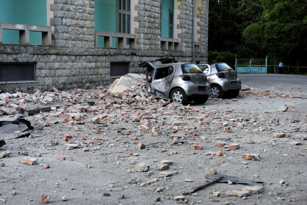 Damaged cars outside the Faculty of Geology building after an earthquake in Tirana, Saturday, Sept. 21, 2019. Albania's government and news reports say an earthquake with a preliminary magnitude of 5.8 shook in the country's west and injured at least two people. (AP Photo/Hektor Pustina)