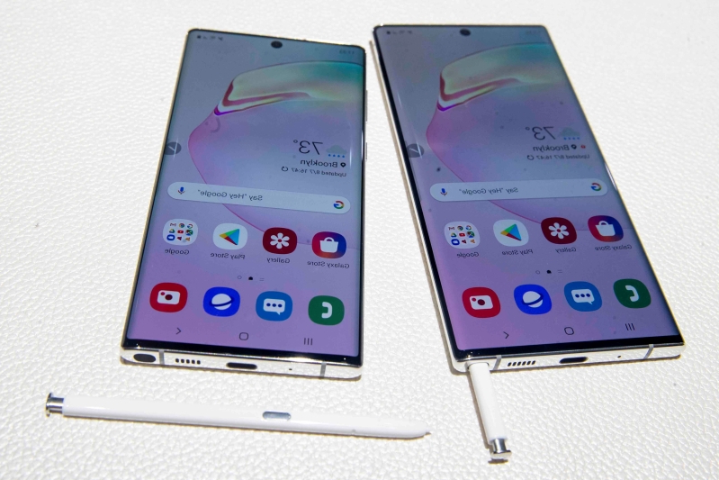 "FILE - This Aug. 7, 2019 file photo shows the Samsung Galaxy Note 10, right, and the Galaxy Note 10 Plus on display during a launch event in New York. If you're among the ""early adopters"" who need to be first on the block for every technological advancement, you'll need a 5G phone with Android. Samsung, Motorola, LG and OnePlus are among the companies that already have 5G models using Google's operating system. Apple isn't expected to release a 5G iPhone until next year. (AP Photo/Mary Altaffer, File)"