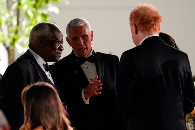 Slide 4 of 16: U.S. Vice President Mike Pence speaks with Supreme Court Justice Clarence Thomas during a state dinner for Australia's Prime Minister Scott Morrison in the Rose Garden of the White House in Washington