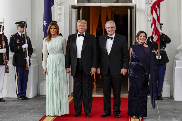 Slide 9 of 16: U.S. President Donald Trump and U.S. first lady Melania Trump greet Australia's Prime Minister Scott Morrison and his wife Jenny Morrison as they arrive for a state dinner at the White House in Washington, U.S., September 20, 2019.      REUTERS/Joshua Roberts